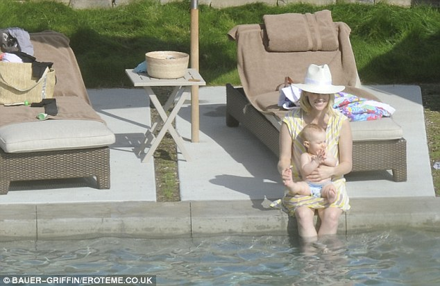 Baby's first pool party! January Jones and her baby Xander enjoyed a Sunday afternoon get-together with friends in Topanga Canyon, California