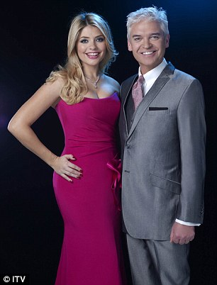 A lady of many talents: Holly went from presenting Dancing On Ice with Philip (L) to fronting BBC'S The Voice with Reggie Yates