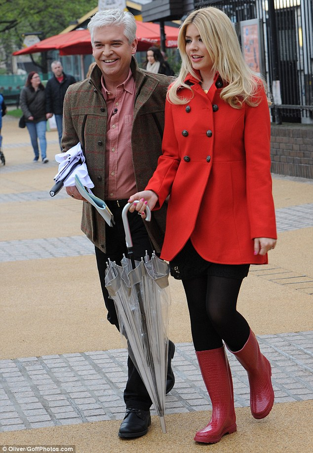 Ready for a rainy day: The blonde teamed her wellies with a bright red coat as she filmed This Morning alongside Philip Schofield