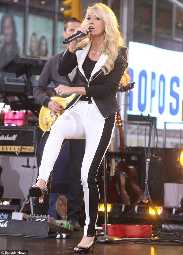 Belting out the tunes: The star took to the stage in Times Square to perform her new track titled Good Girl from the LP