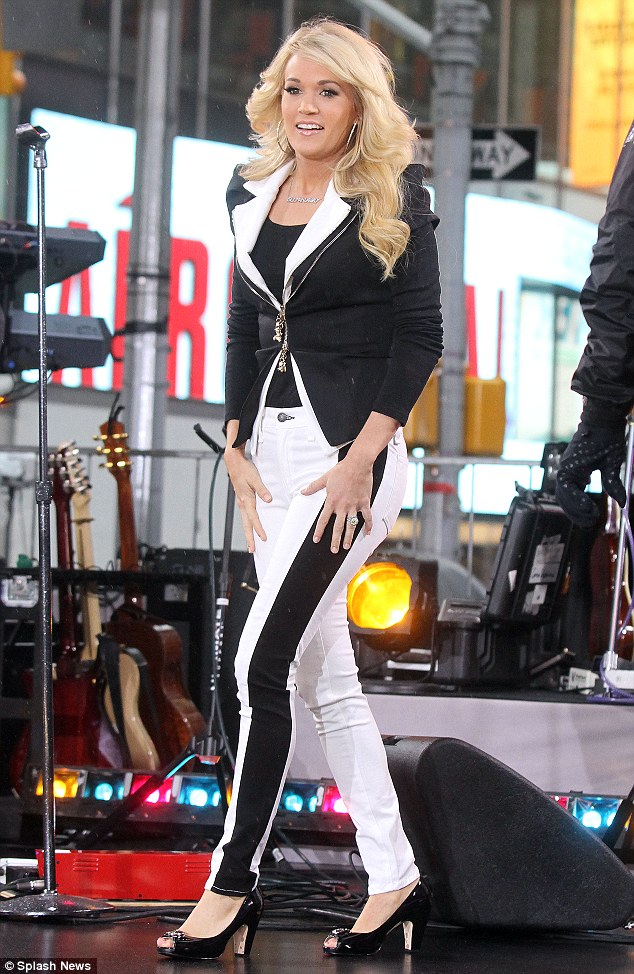 The two tone effect: Carrie Underwood pulled off her black and white monochrome jeans, from Rag & Bone,  and tuxedo jacket as she took to the stage on Good Morning America today