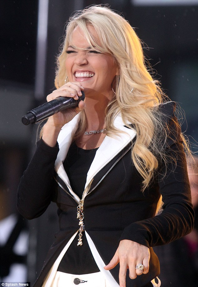Promoting: The blonde beauty wore a bejeweled necklace which spelled out the name of her new album, Blown Away
