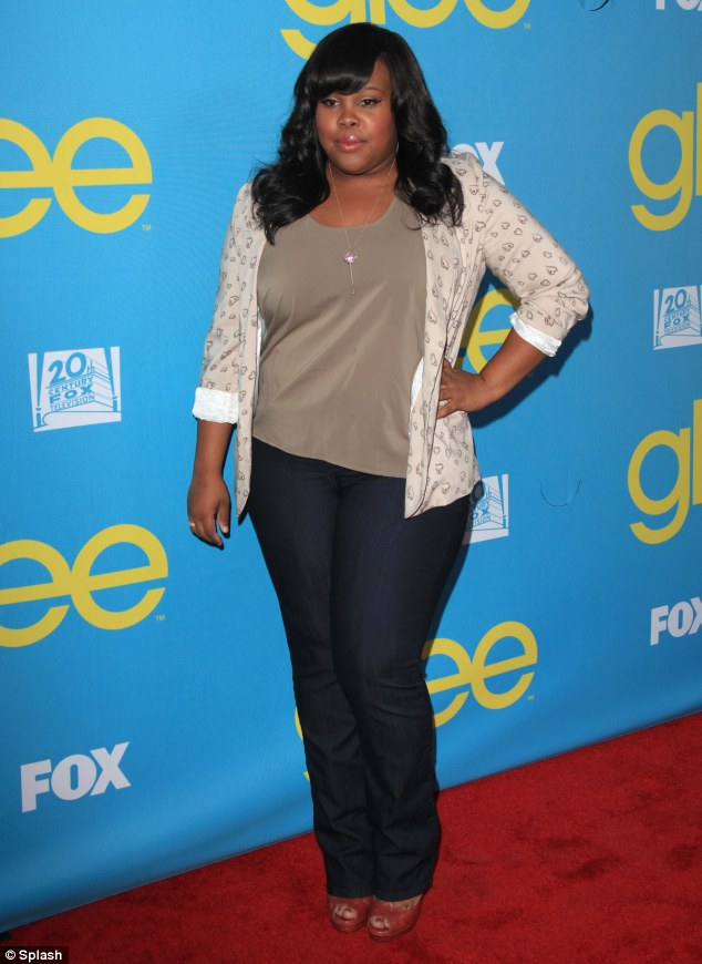 I'm a red carpet amateur: Glee's Amber Riley looks nervous at the Hollywood screening of the show before she collapsed in front of assembled photographers