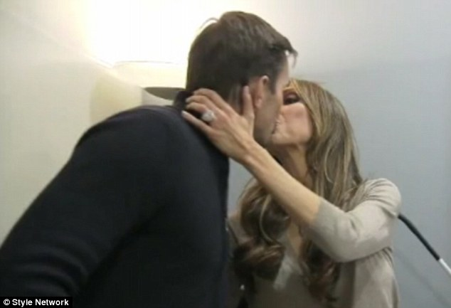 Kissing couple: The pair were seen sharing an affectionate moment during their visit