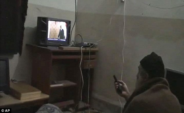 Watching: In this undated image from video seized from bin Laden's compound, the Al-Qaeda chief watches a TV programme showing an image of President Obama