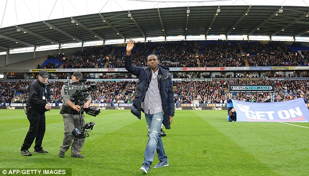 Welcome back: Fabrice Muamba takes to the pitch before the match between Bolton and Tottenham