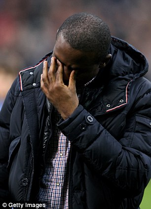 Tearful: Muamba shows his emotion