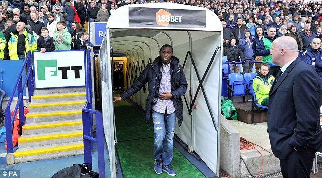 Tunnel vision: Muamba looks on from the players' tunnel before heading out on to the pitch