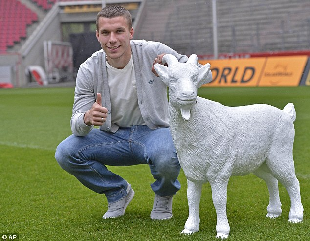 Feed the goat and he will score: Lukas Podolski poses with the FC Cologne mascot
