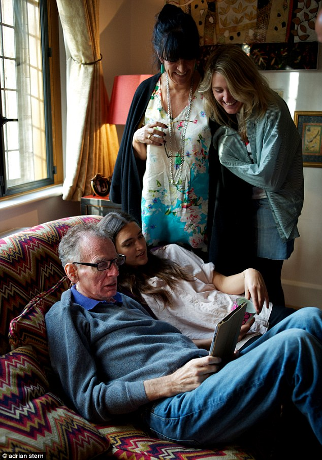 Coping together: Philip Gould and wife Gail with daughters Georgia, standing, and Grace, in the last picture taken of him before his death last year