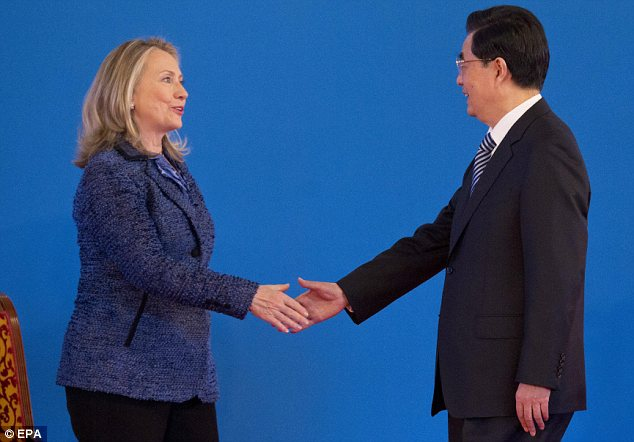 Tricky: The diplomatic row could now have come at a worse time for Hillary Clinton (left), who is in China for two days of strategic talks with Chinese President Hu Jintao (right)