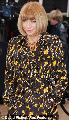 Power: The model presented a cheque to Anna Wintour, pictured above at London Fashion Week in February