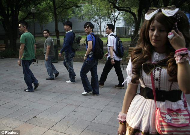 Passers-by look at a member of the Lolitas Paradise club in Monterrey