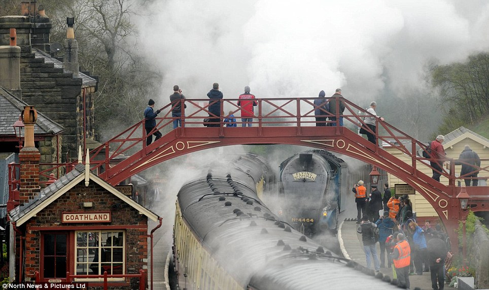 Spectacle: Crowds gather on the bridge as the vintage steam engine passes underfoot