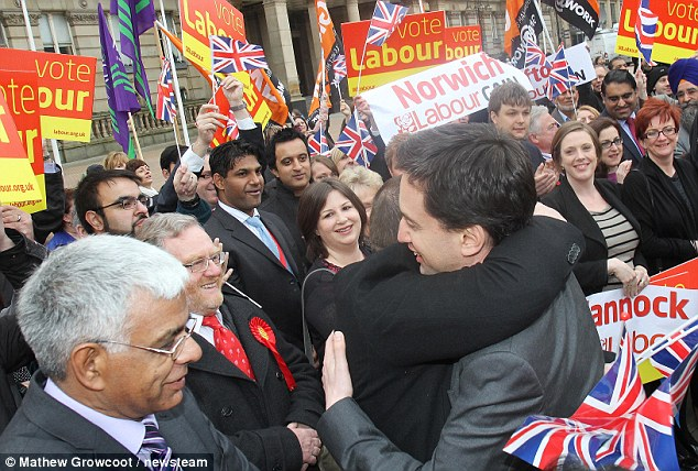 Hug a brummie:  Mr Miliband embraces victorious councillors in Birmingham  today