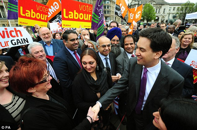 Meet and greet: A very pleased Ed Miliband, surrounded by party placards and Union flags, shakes hands with Labour voters as he celebrates in Birmingham on Friday