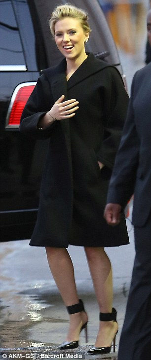 Killer heels: Scarlett smiled and waved at fans outside the studio as she tottered in in spiky stilettos