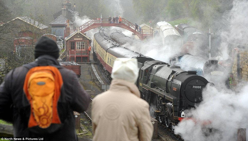 Star attractions: The 4464 Bittern was almost entirely obscured by steam as it pulled level with the British Rail Standard Pacific No 70000