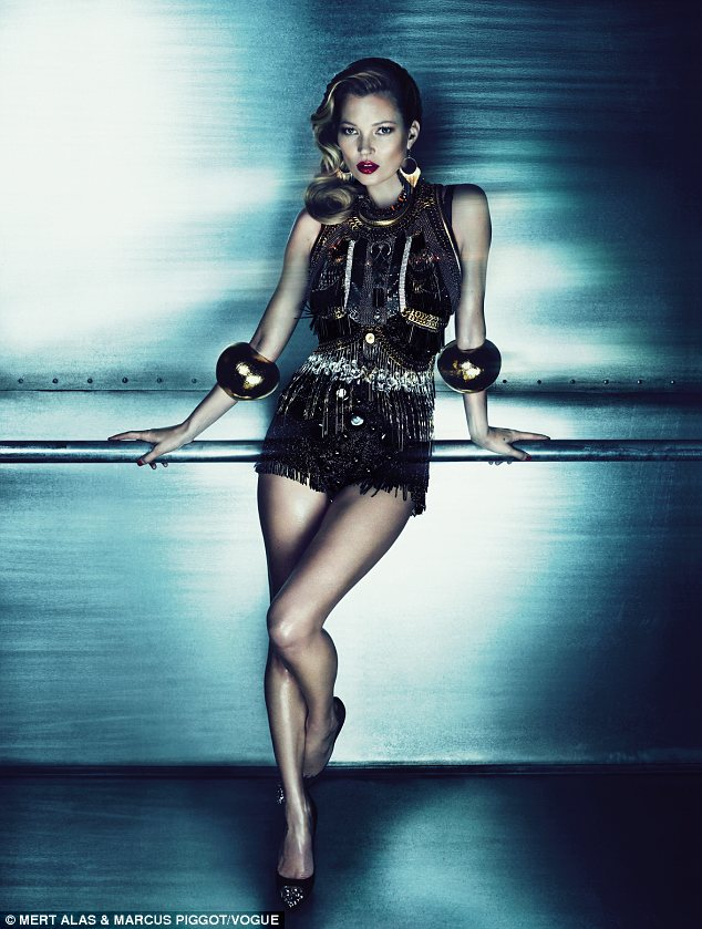 Dazzling: A second picture of the model, printed inside the magazine, sees her wear a Dolce & Gabbana crystal-embroidered body, Erickson Beamon gold chainmail vest and Louis Vuitton shoes