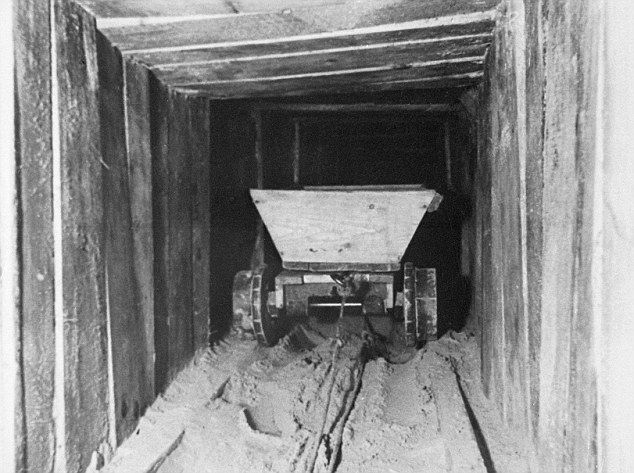 The Great Escape: A trolley in the famous Harry escape tunnel originally built by Allied airmen at the German Stalag Luft III prisoner of war camp, in Zagan, Poland