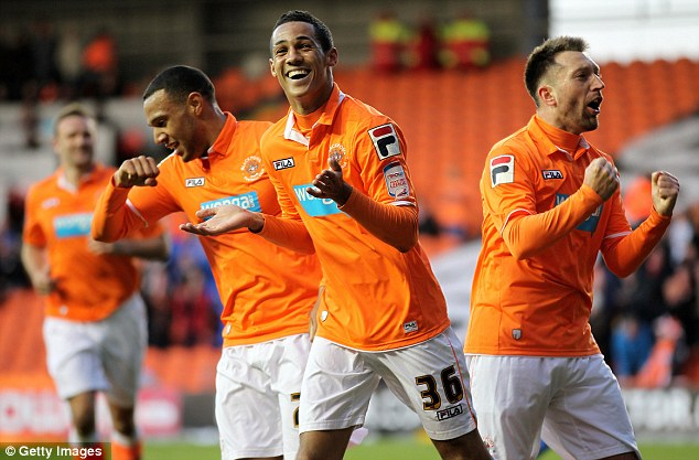 Delight: Thomas Ince celebrates with his team-mates after breaking the deadlock
