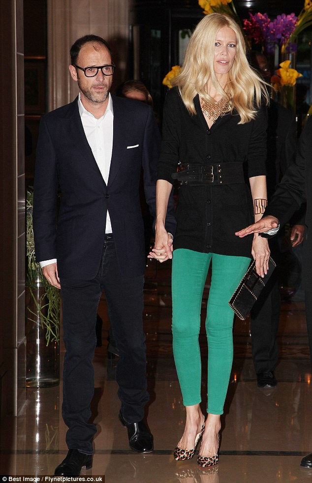 Cheer up! Matthew Vaughn looks glum as Claudia Schiffer steals the show at the Guess 30th birthday in Paris