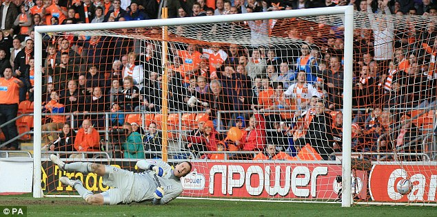 Going behind: Colin Doyle sees Blackpool's Tom Ince's deflected shot go past him for only goal of the game