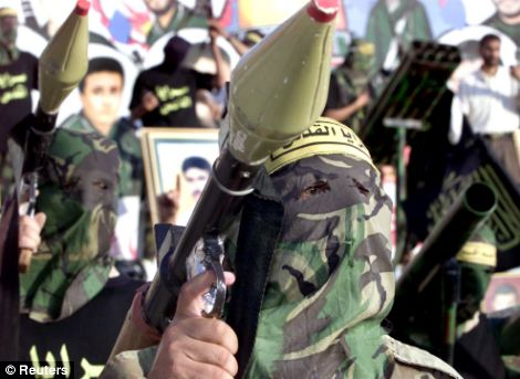 Allegations: A rocket is held aloft by a masked member of Islamic Jihad, the banned organisation which Israel is claiming Hahlaleh and Diab are members of