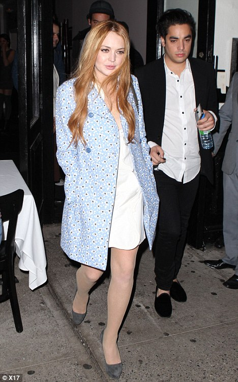 Ready for business: Lindsay Lohan dressed the part on Saturday night for a power dinner with Woody Allen