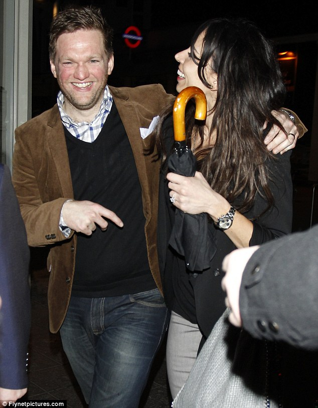 Sharing a laugh: Bleakley jokes with a male friend as they head out of the club