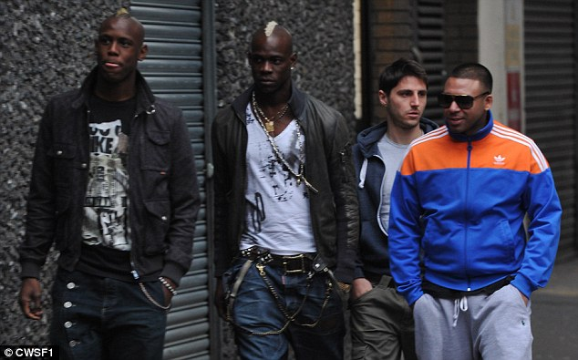 Entourage: Balotelli, who didn't make the squad for Sunday's win over Newcastle, dined out at his favourite restaurant