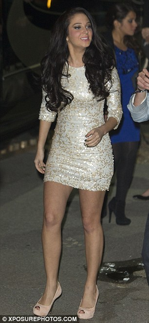 Quick change: The singer was pictured returning to her trailer from the stage, and leaving the studio later in a mini dress and heels