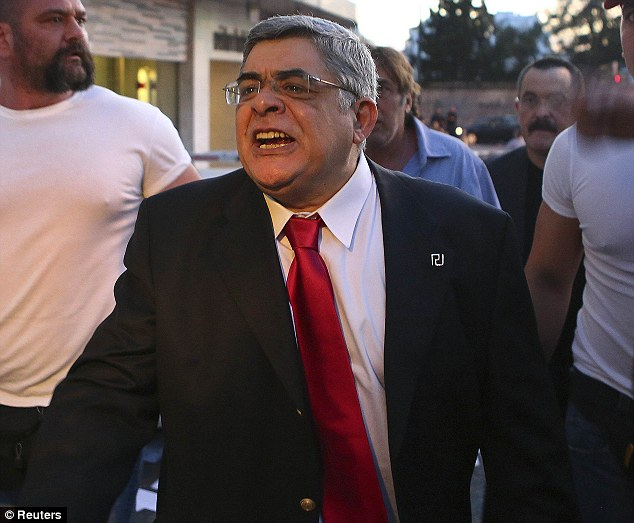 Seats victory: Leader of extreme-right Golden Dawn party Nikolaos Mihaloliakos (centre) pledges to 'get all immigrants out of the country' after they secured their first seats in Parliament