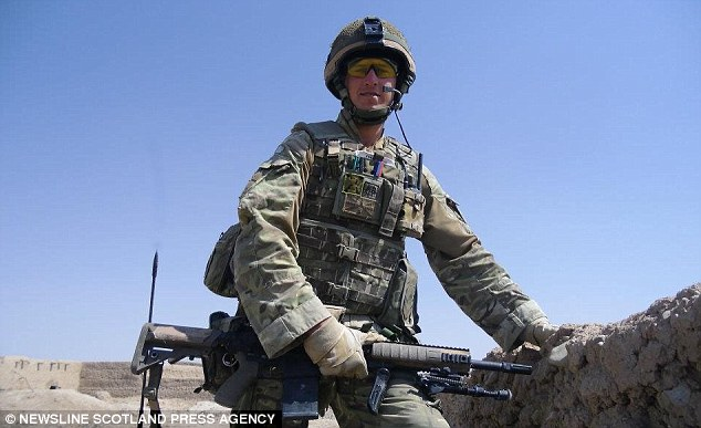 Ready for action: The young soldier in full battle gear before he was nearly killed in Afghanistan