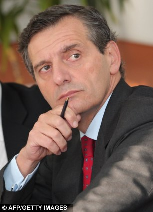 Injured: Nuclear power firm chief Roberto Adinolfi, 53, was shot in the leg outside his home in Genoa
