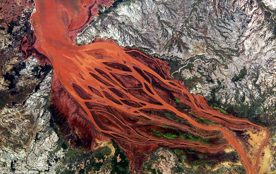 Rivers from Hell? Nope - this is the Betsiboka estuary in Madagascar, which carries lots of reddish silt down to the sea - natural erosion is causing a lot of damage to the area