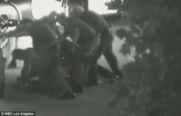 Subduing: Thomas screamed out in pain as he was being tasered