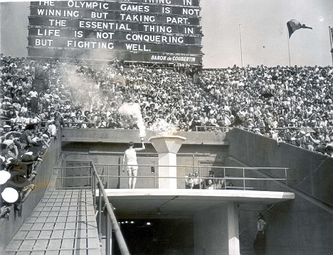 Games on: Mark lights the flame to open the 1948 Olympics