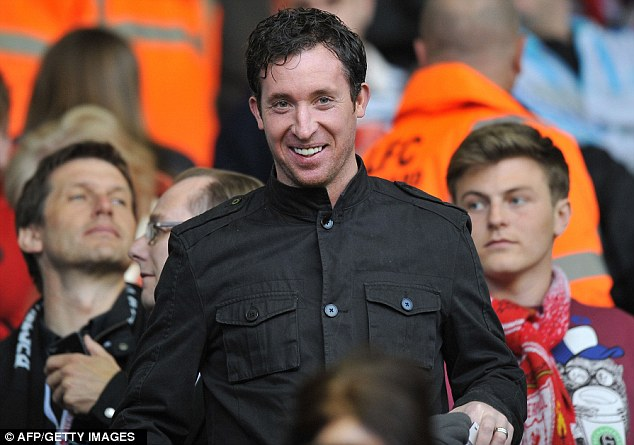 Local hero: Liverpool legend Robbie Fowler takes his seat at Anfield before the match
