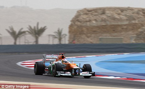 On the up: Paul di Resta finished sixth in Bahrain and has been tipped to a move to Ferrari by Sir Jackie Stewart