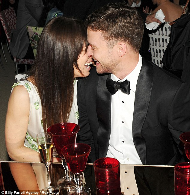 Loved up: Jessica Biel and Justin Timberlake engage in rare PDA at the Met Gala in New York on Monday