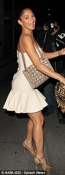 Flirty post thirty: Nicole looked cute in a short skirt dress and snakeskin heels