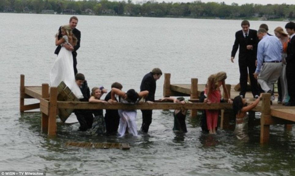 Disaster strikes! The students plunge into the lake as the wooden pier collapses under their collective weight