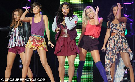 Mollie and The Saturdays in action, performing on stage at the Sainsburys Super Saturday festival in Clapham Common last year.
