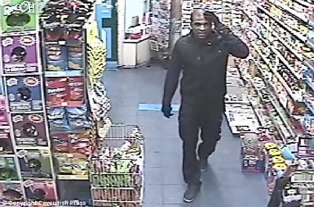 Nonchalant: The caffeine-loving robber's accomplice doesn't even worry about covering his face as he enters the store. Police have released these images in the hope someone will come forward with information