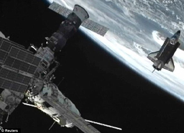 The International Space Station (front) says goodbye to the Endeavour as it heads back to Earth