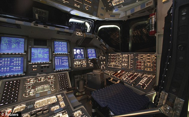 Taxi driver: This is the pilot's seat of the recently-retired Endeavour, as NASA looks around for a new company to get a lift from