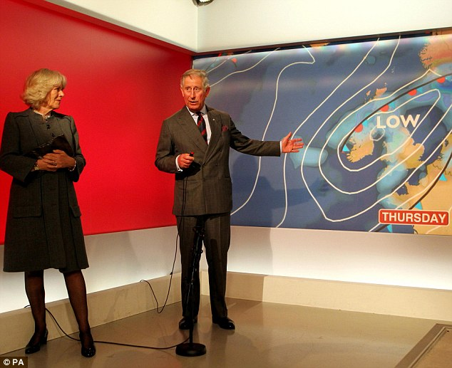 Camilla looks on as Charles motions towards areas of low pressure