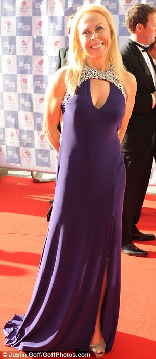 Purple lady: Jayne Torvill wore a floor-sweeping dress that featured a jewel-encrusted collar