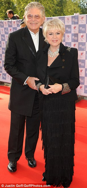 Not alone: Bear Grylls brought wife Shara along while Gloria Hunniford arrived with a male guest